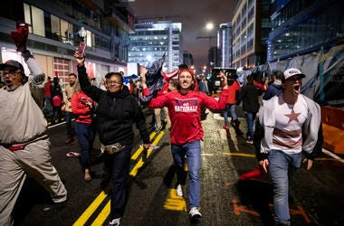 Washington Nationals fans stream into the streets outside of Nationals Park celebrating the Nationals World Series victory on October 30, 2019 in Washington, DC. The Washington Nationals defeated the Houston Astros 6-2 in Game 7 of the World Series bringi