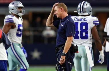 Head coach Jason Garrett of the Dallas Cowboys rubs his head during the game against the Buffalo Bills at AT&T Stadium