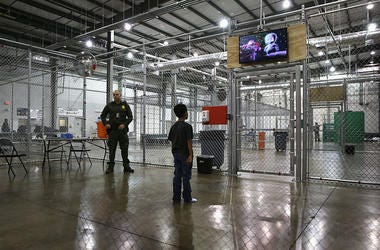 A boy from Honduras watches a movie at a detention facility run by the U.S. Border Patrol on September 8, 2014 in McAllen, Texas. The Border Patrol opened the holding center to temporarily house the children after tens of thousands of families and unaccom