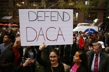 woman holding sign in support of DACA