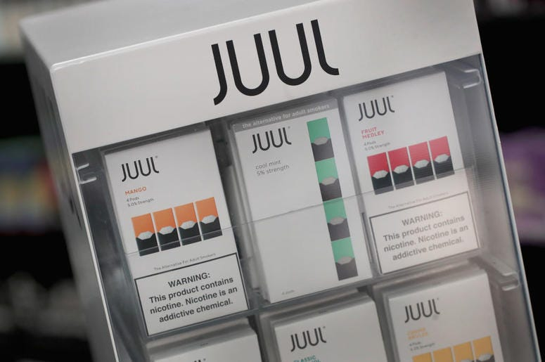 Electronic cigarettes and pods by Juul, the nation's largest maker of vaping products, are offered for sale at the Smoke Depot on September 13, 2018 in Chicago, Illinois. The Food and Drug Administration (FDA) has ordered e-cigarette product makers to dev