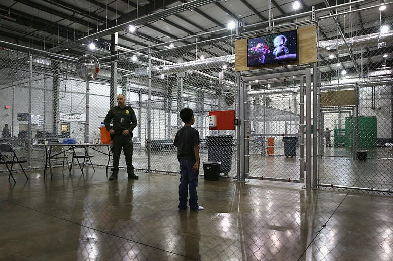 A boy from Honduras watches a movie at a detention facility run by the U.S. Border Patrol on September 8, 2014 in McAllen, Texas. The Border Patrol opened the holding center to temporarily house the children.