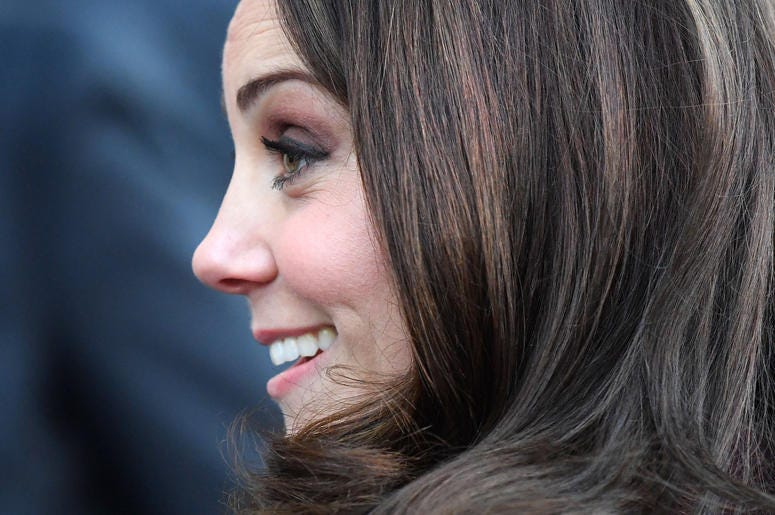 Kate Middleton smiles in profile