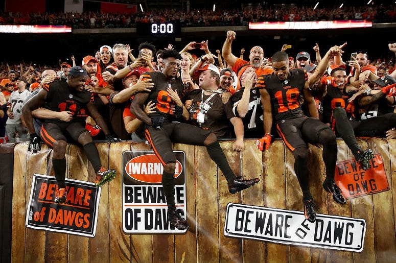 Antonio Callaway #11, Rashard Higgins #81 and Damion Ratley #18 of the Cleveland Browns celebrate with fans