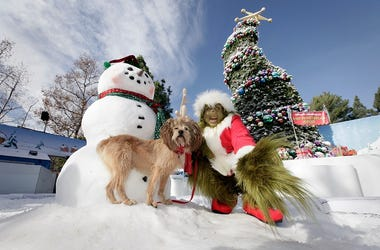 Grinch poses with Max the Dog