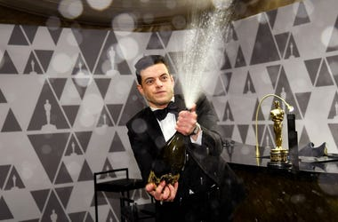 Rami Malek sprays champagne during the 91st Annual Academy Awards Governors Ball