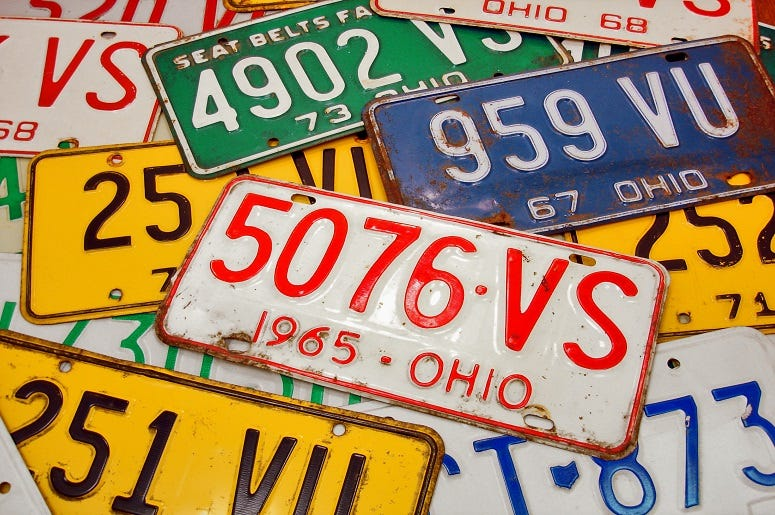 Various vintage Ohio license plates from the late 60's and early 70's arranged in a collage.