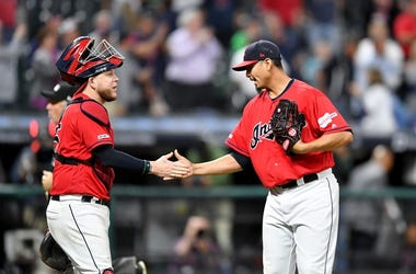 Catcher Roberto Perez #55 celebrates with closing pitcher Carlos Carrasco #59 of the Cleveland Indians