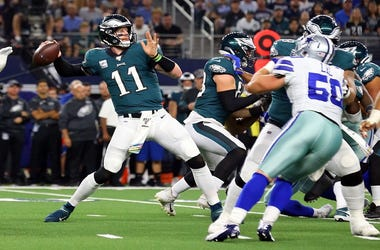 Carson Wentz #11 of the Philadelphia Eagles passes against the Dallas Cowboys at AT&T Stadium on October 20, 2019