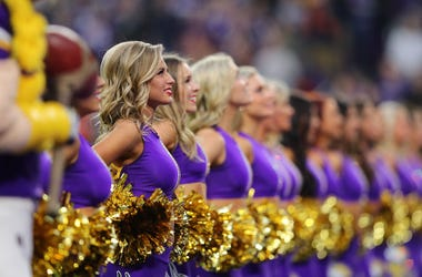 in Minnesota Vikings cheerleaders line up for the national anthem before the game against the Chicago Bears at U.S. Bank Stadium on December 29, 2019 in Minneapolis, Minnesota.