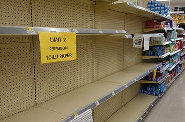 Empty shelves are seen where toilet paper normally is kept when people stocked up as the city government continues to take steps to fight the coronavirus outbreak