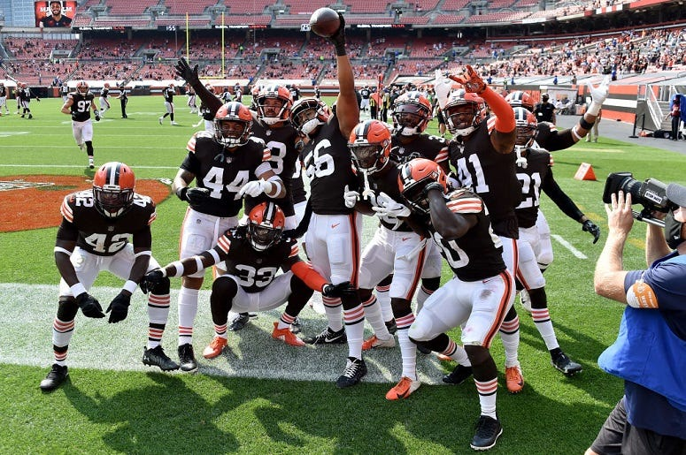 Malcolm Smith #56 of the Cleveland Browns celebrates with his teammates after an interception against Dwayne Haskins #7 of the Washington Football Team