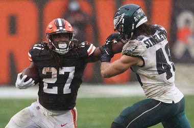 Kareem Hunt is pursued by Alex Singleton during the second half at FirstEnergy Stadium on November 22, 2020