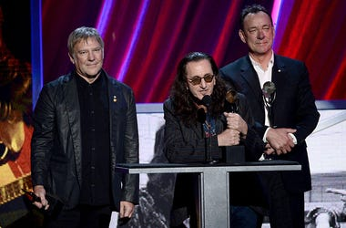 Inductees Alex Lifeson, Geddy Lee and Neil Peart of Rush speak on stage at the 28th Annual Rock and Roll Hall of Fame Induction Ceremony
