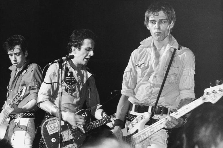 left to right, Mick Jones, Joe Strummer and Paul Simonon of punk rock band The Clash, circa 198