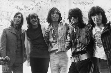 20-year-old Mick Taylor, former lead guitarist of the John Mayall rhythm and blues group replaces Brian Jones as the new member of the Rolling Stones. The group pose in Hyde Park, London - (from left to right) Charlie Watts, Mick Taylor, Mick Jagger, Kei