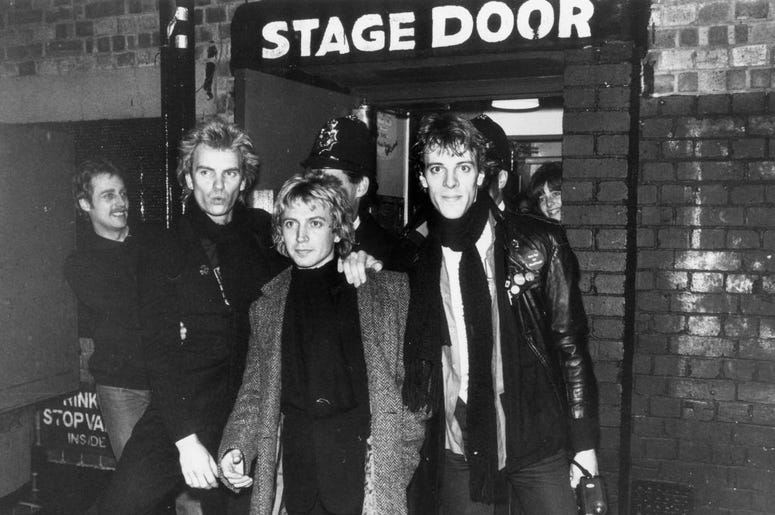 left to right, they are Sting, Andy Summers and Stewart Copeland