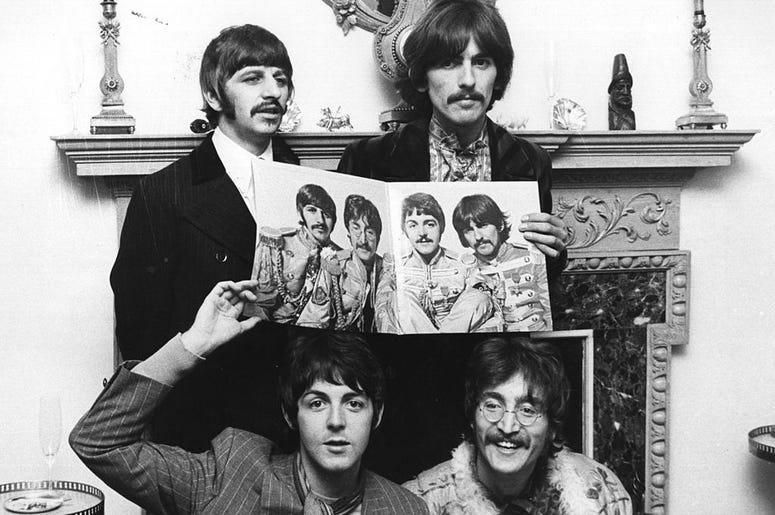 The Beatles (clockwise from top left: Ringo Starr, George Harrison (1943 - 2001), John Lennon (1940 - 1980) and Paul McCartney) pose for a photocall to promote their new album 'Sergeant Pepper's Lonely Hearts Club Band'.