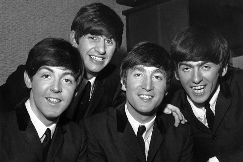 Paul McCartney, Ringo Starr, John Lennon (1940 - 1980) and George Harrison (1943 - 2001) of British pop group The Beatles.