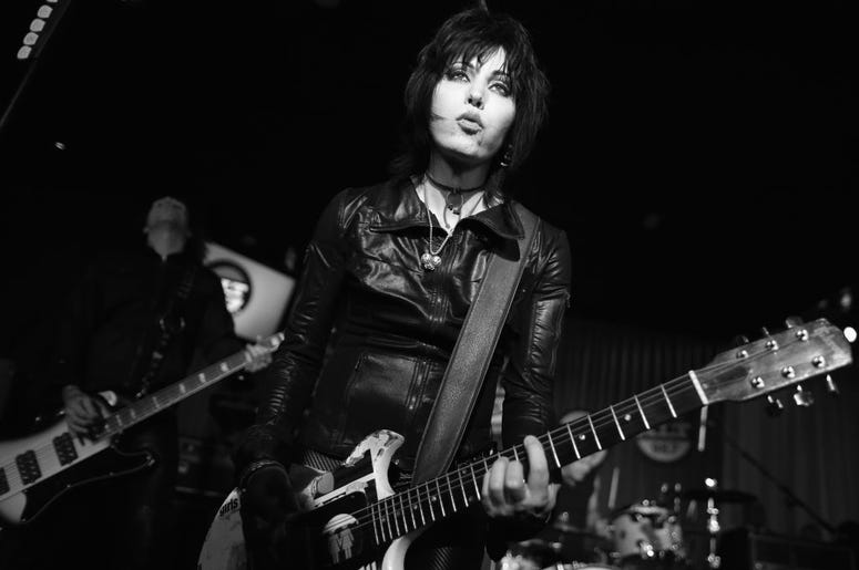 Musician Joan Jett performs at The ALTimate Rooftop Christmas Party at W Hollywood on December 9, 2013 in Hollywood, California.