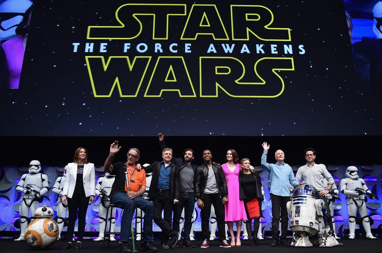(L-R) Producer Kathleen Kennedy, actors Peter Mayhew, Mark Hamill, Oscar Isaac, John Boyega, Daisy Ridley, Carrie Fisher, Anthony Daniels and director J.J. Abrams speak onstage during Star Wars Celebration 2015 on April 16, 2015 in Anaheim, California.