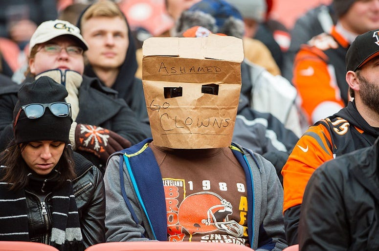 A Cleveland Browns fan expresses their disappointment with the team during the second half against the Cincinnati Bengals