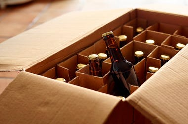 Unpacking a package of beer bottles from different breweries.