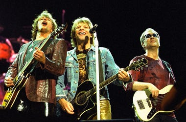 Left to right, Richie Sambora, Jon Bon Jovi and Hugh McDonald of the band Bon Jovi perform