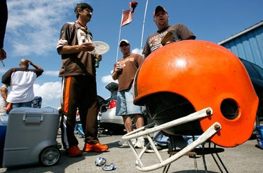 Fans tailgate before the game