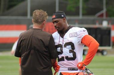 Browns cornerback Damarious Randall speak with defensive coordinator Gregg Williams during OTAs on May 30, 2018