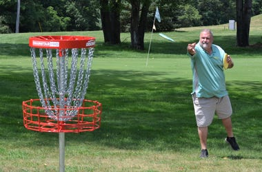 Course designer Jeff Carter makes a throw at the new Springbrook Disc G1.JPGolf Course, which opened earlier this month. springbrook disc golf 1.JPG
