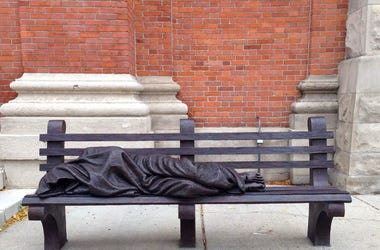 "A ""Homeless Jesus\"" statue is in front of Saints Peter and Paul Jesuit church in downtown Detroit. St Peter Paul Jesuit3"
