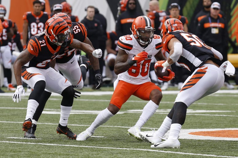 Cleveland Browns wide receiver Jarvis Landry (80) runs against Cincinnati Bengals defensive back Darqueze Dennard (21) and outside linebacker Jordan Evans (50) during the first half at Paul Brown Stadium
