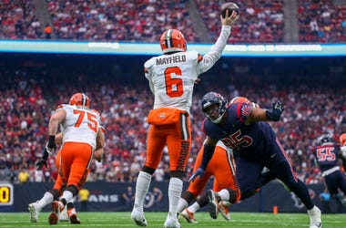 Dec 2, 2018; Houston, TX, USA; Cleveland Browns quarterback Baker Mayfield (6) throws a pass while being pursued by Houston Texans defensive end Christian Covington (95) during the fourth quarter at NRG Stadium. Mandatory Credit: John Glaser-USA TODAY Spo