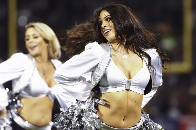 Oakland Raiders cheerleaders perform during a timeout against the Denver Broncos during the fourth quarter at Oakland Coliseum.