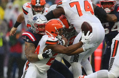 New England Patriots defensive lineman Lawrence Guy (93) forces a fumble by Cleveland Browns running back Nick Chubb (24) during the first quarter at Gillette Stadium.
