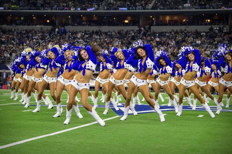 The Dallas Cowboys cheerleaders perform during the game between the Cowboys and the Buffalo Bills at AT&T Stadium.
