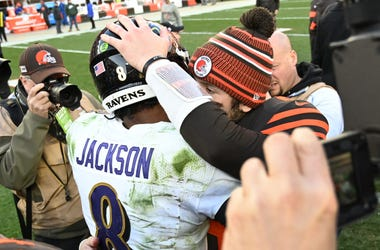 Cleveland Browns quarterback Baker Mayfield (6) and Baltimore Ravens quarterback Lamar Jackson (8) hug after the game at FirstEnergy Stadium.