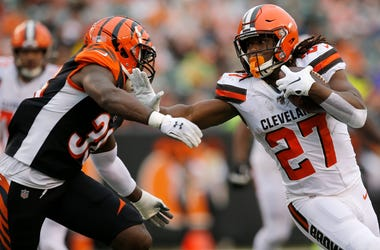 Cleveland Browns running back Kareem Hunt (27) stiff arms Cincinnati Bengals strong safety Shawn Williams (36) on a carry in the fourth quarter of the NFL Week 17 game between the Cincinnati Bengals and the Cleveland Browns at Paul Brown Stadium in downto