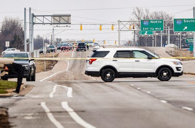Traffic builds up because of a road closure on 56th and Brendon Forest Dr., because of a police chase near the northeast side of Indianapolis, Tuesday, Feb. 11, 2020. IMPD officers are investigating a shooting after a police pursuit from a shoplifting cal
