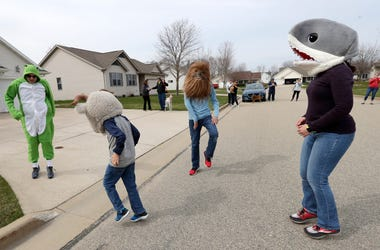 The Behrendt family participates in the statewide Jump Around Wisconsin movement, where people are encouraged to go out in their driveways at the same time and dance along Saturday, April 11, 2020, in Menasha, Wis. WIXX-FM in Green Bay was happy to lead t