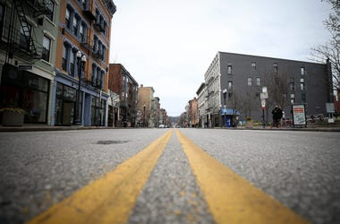 View looking north of Vine Street, Tuesday, March 24, 2020, in Cincinnati's Over-the-Rhine neighborhood. Tuesday was the first day of Ohio Gov. Mike DeWine's shelter-in-place order in response to the new coronavirus pandemic. All non-essential businesses
