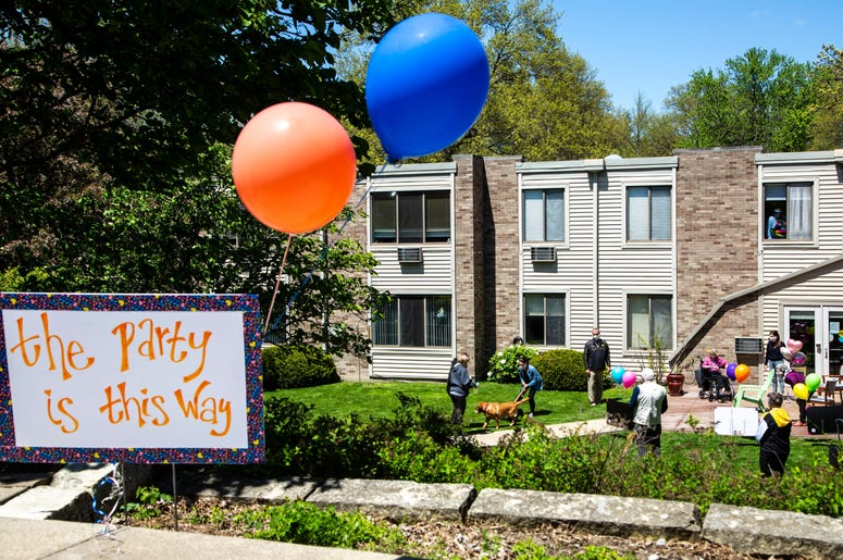 Balloons help direct people towards a party for Jeanne Kuentzel while she celebrates her 100th birthday with family members and Oaknoll staff, Friday, May 8, 2020, at Oaknoll Retirement Residence in Iowa City, Iowa. 200508 Birthday 100 001 Jpg