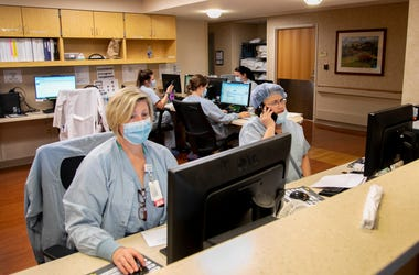 FOR SPECIAL PACKAGE: Nurses at TriHealth Good Samaritan Hospital, track patient care, Friday, April 24, 2020. Since the new coronavirus pandemic, health care workers have become the nation's heroes and more safety protocols are in place for both the healt