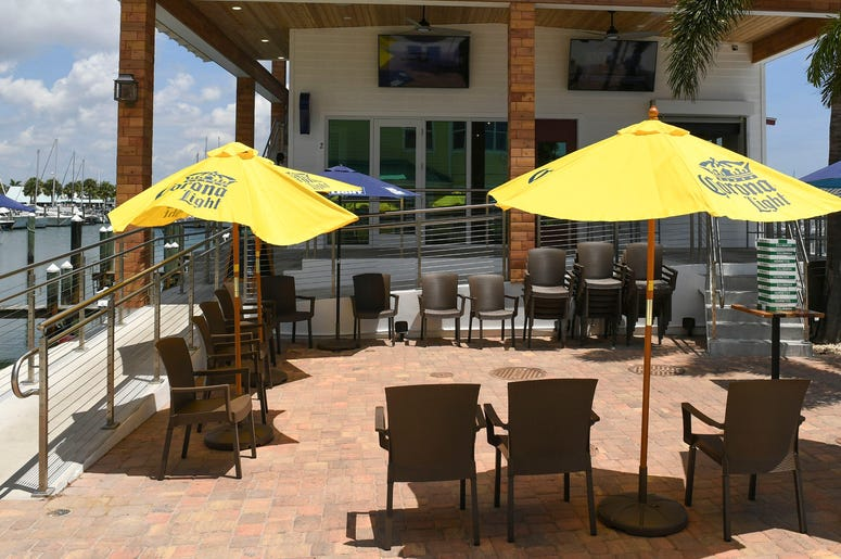 Customers arrive for lunch at the new Crabby's Dockside restaurant just after they opened for lunch on Monday, July 6, 2020, at the Fort Pierce City Marina. The new $1.4 million restaurant first opened their doors on June 25, and opened for their full lun
