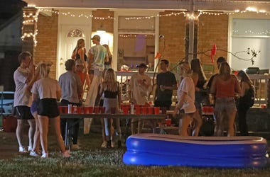 Off-campus porch and yard parties near the Ohio State University campus in Columbus were packed Thursday, August 20, 2020. Few masks were visible even though the COVID-19 pandemic is rampant. A mix of online and in-person classes begin August 25, 2020 at