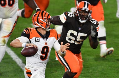 Sep 17, 2020; Cleveland, Ohio, USA; Cleveland Browns defensive tackle Larry Ogunjobi (65) chases Cincinnati Bengals quarterback Joe Burrow (9) during the second half at FirstEnergy Stadium. Mandatory Credit: Ken Blaze-USA TODAY Sports