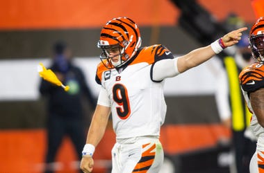 Sep 17, 2020; Cleveland, Ohio, USA; Cincinnati Bengals quarterback Joe Burrow (9) signals to the Cleveland Browns for an encroachment penalty as a flag is thrown during the third quarter at FirstEnergy Stadium. Mandatory Credit: Scott Galvin-USA TODAY Spo