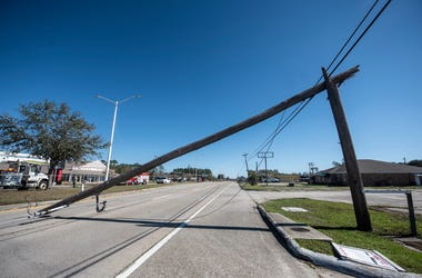 A fallen utility pole lays across U.S. Highway 90 in Bay St. Louis, Miss. as a result of Hurricane Zeta Thursday, Oct. 29, 2020. Sdw 7239