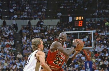 Michael Jordan is defended by Cleveland Cavaliers guard (3) Craig Ehlo at Richfield Coliseum.